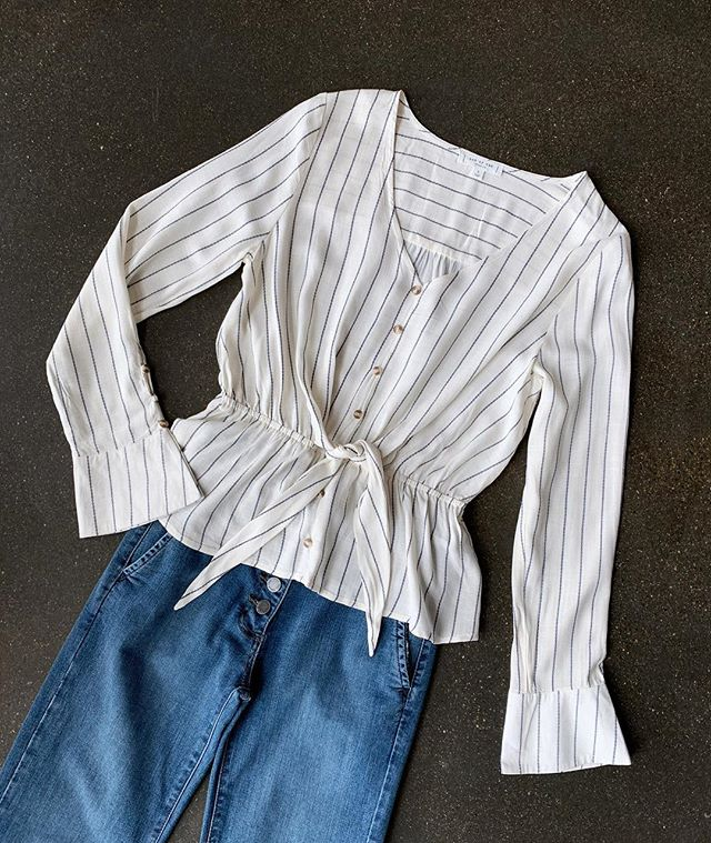 This new striped top layers perfectly under cozy cardigans now and solo with jeans and sandals later.
