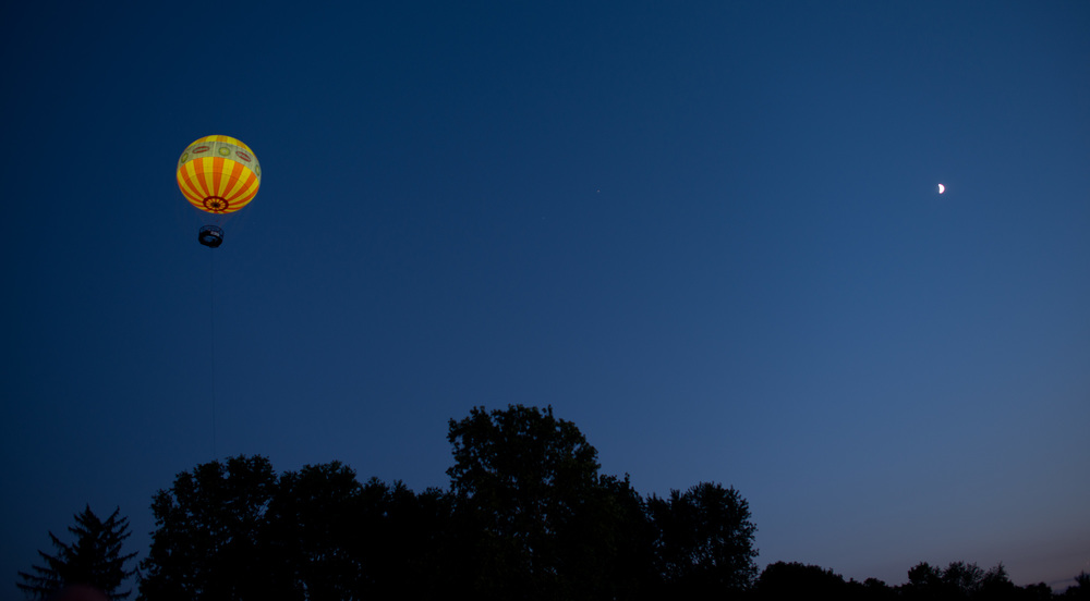 A quarter moon with a glowing hot air balloon entertained the crowd.