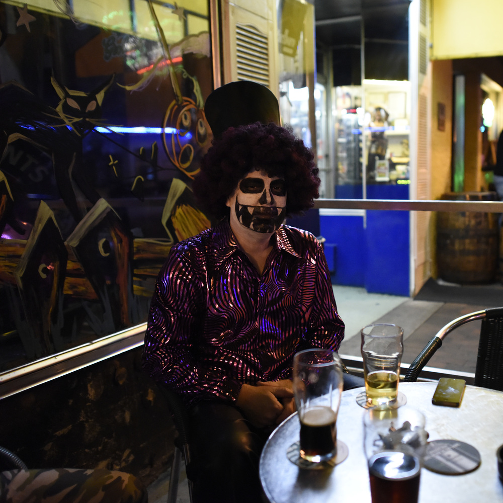 Creepy clown at a bar..