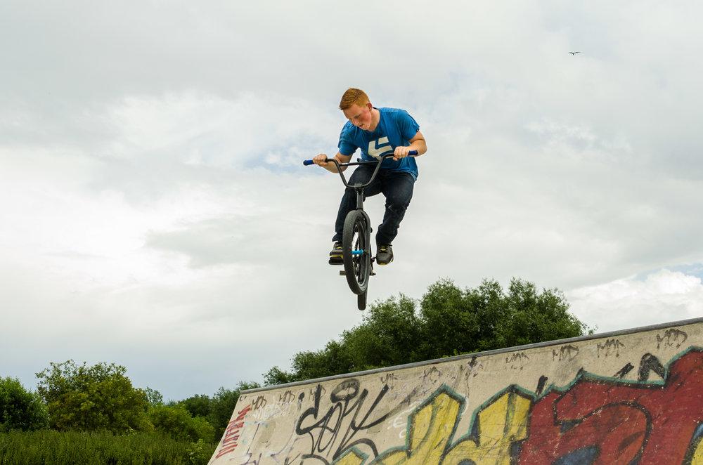 BMX flying over a jump, Stratford skate park 27/06/2014