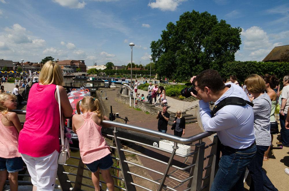 Tourist narrow boat goes through the Bancroft Gardens lock 01/06/2014