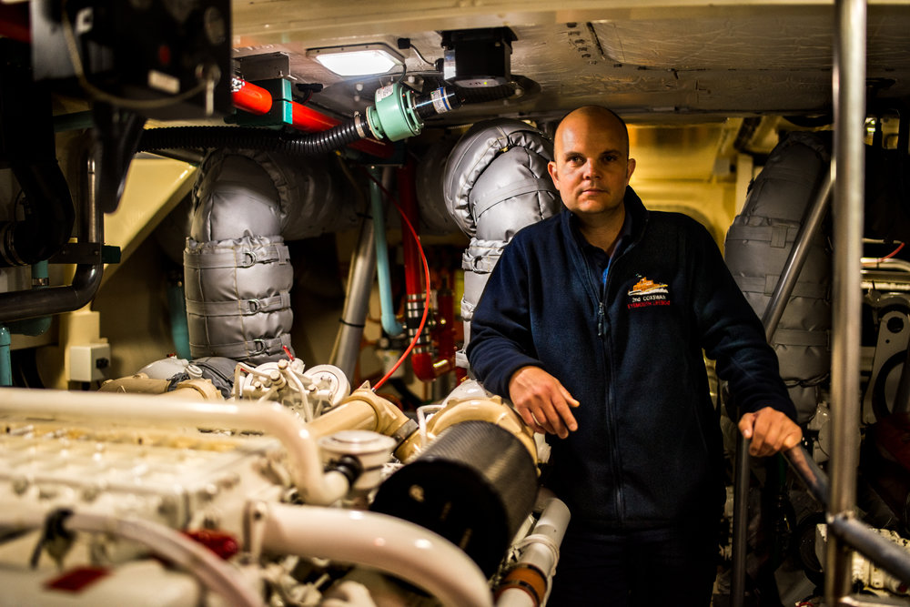 2nd Coxswain and Mechanic Adam Ferguson in the all-weather Trent class's engine room