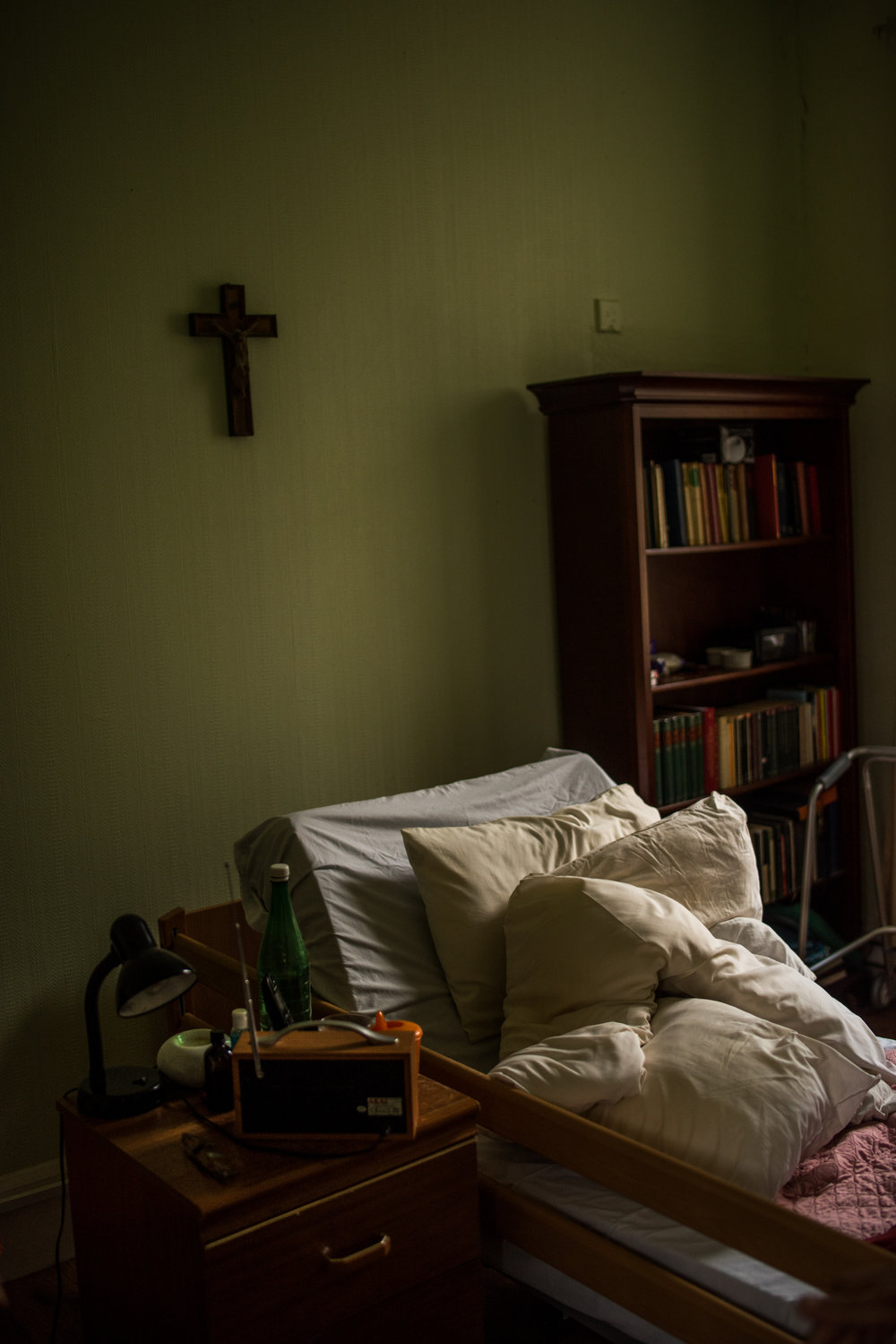 A bed in the infirmary, still warm from the previous Abbot who was buried the day before I got to the Abbey. His personal items are on the table next to the bed and the room smells of mouthwash. Belmont Abbey, Hereford, England 2016