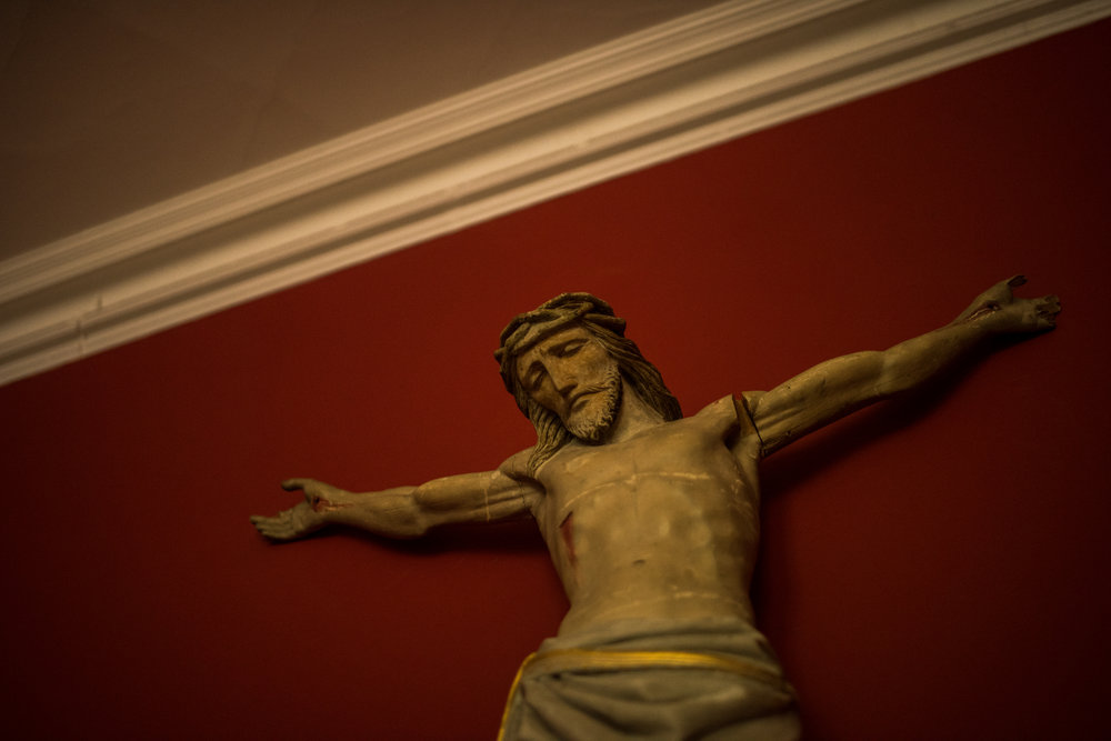 A figure of a crucified Christ, Catholics usually have graphic figures often incorporating blood and emotion. Belmont Abbey, Hereford, England 2016