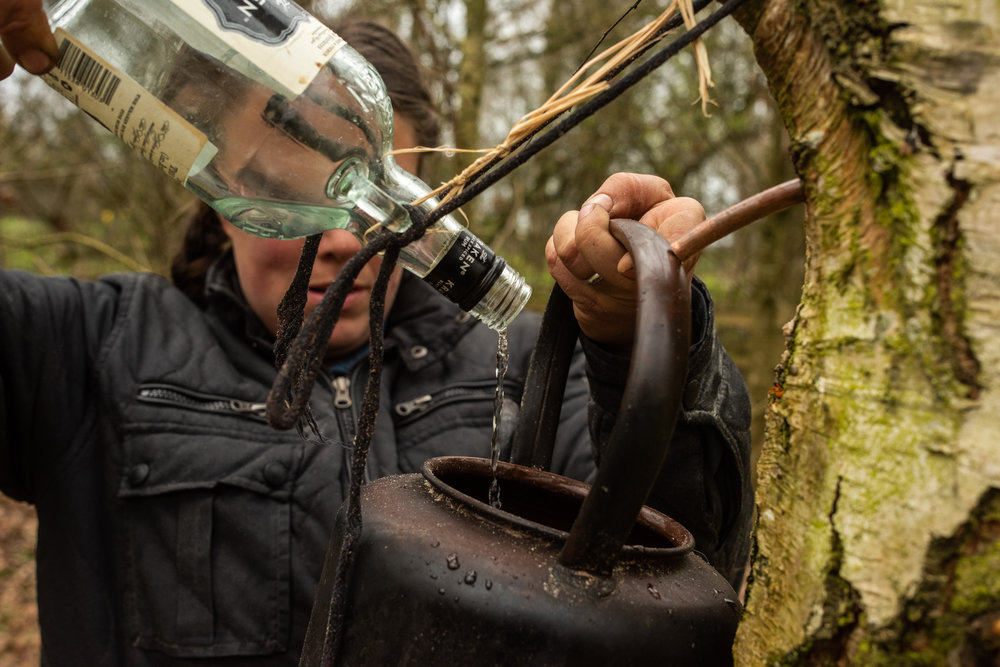 Experimenting with collecting tree sap as she heard it doesn't have the chemicals most water does