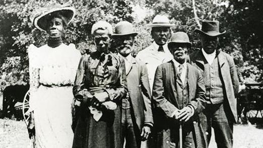 Members of Texas' official Juneteenth Committee pose for a photograph in East Woods Park, Austin, Texas on June 19, 1900.