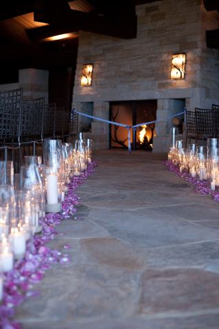 The Flower House Candles and Purple petals on aisle.jpg