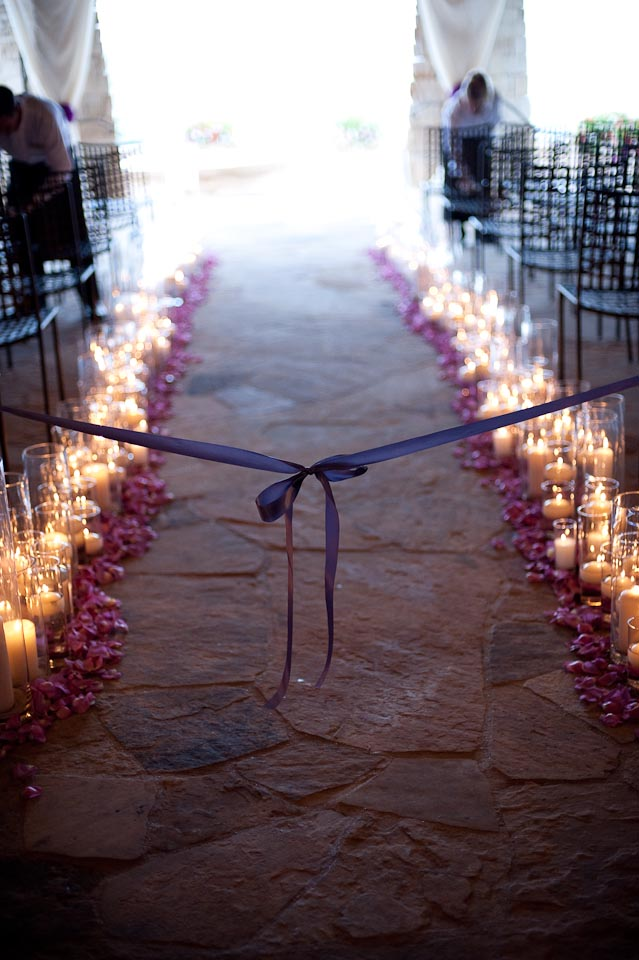 candles and petals lining the ceremony aisle.jpg