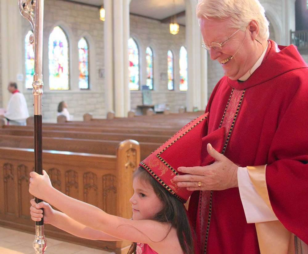 Right Reverend Dean Elliott Wolfe, D.D., Bishop of the Episcopal Diocese of Kansas lends his mitre and crozier to a small protégé.