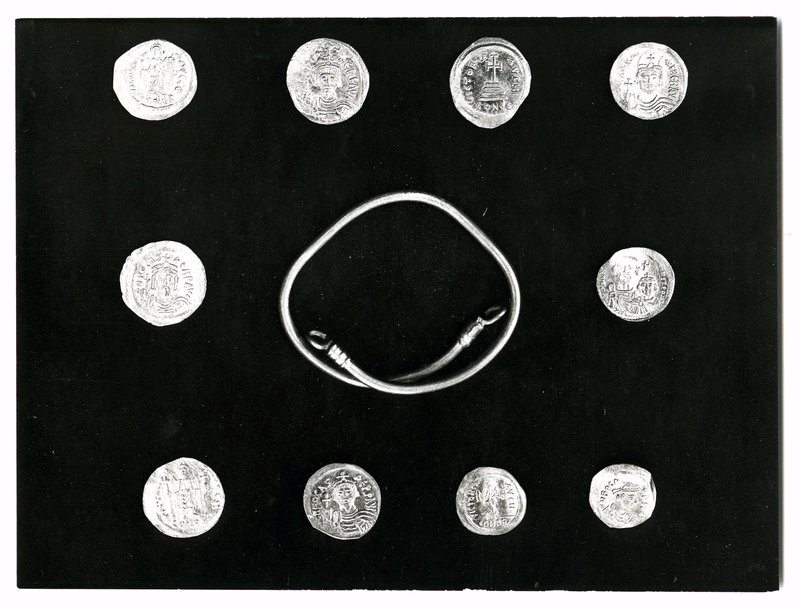 Photograph of the bracelet and gold coins found from the hoard in the Monastery.