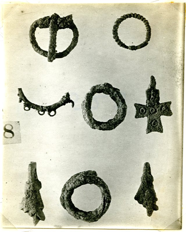 Small bronze objects from the Northern Cemetery, including the fist amulet.