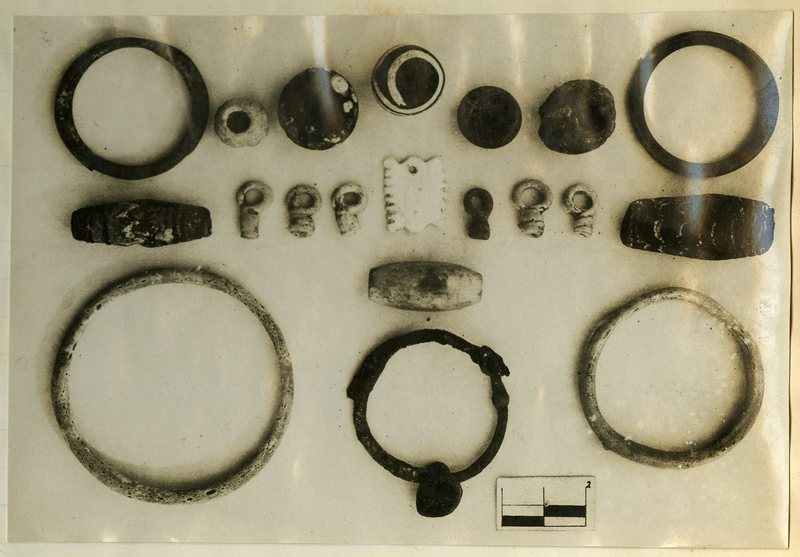Beads, bracelets, and ivory pendants from Tomb 295.