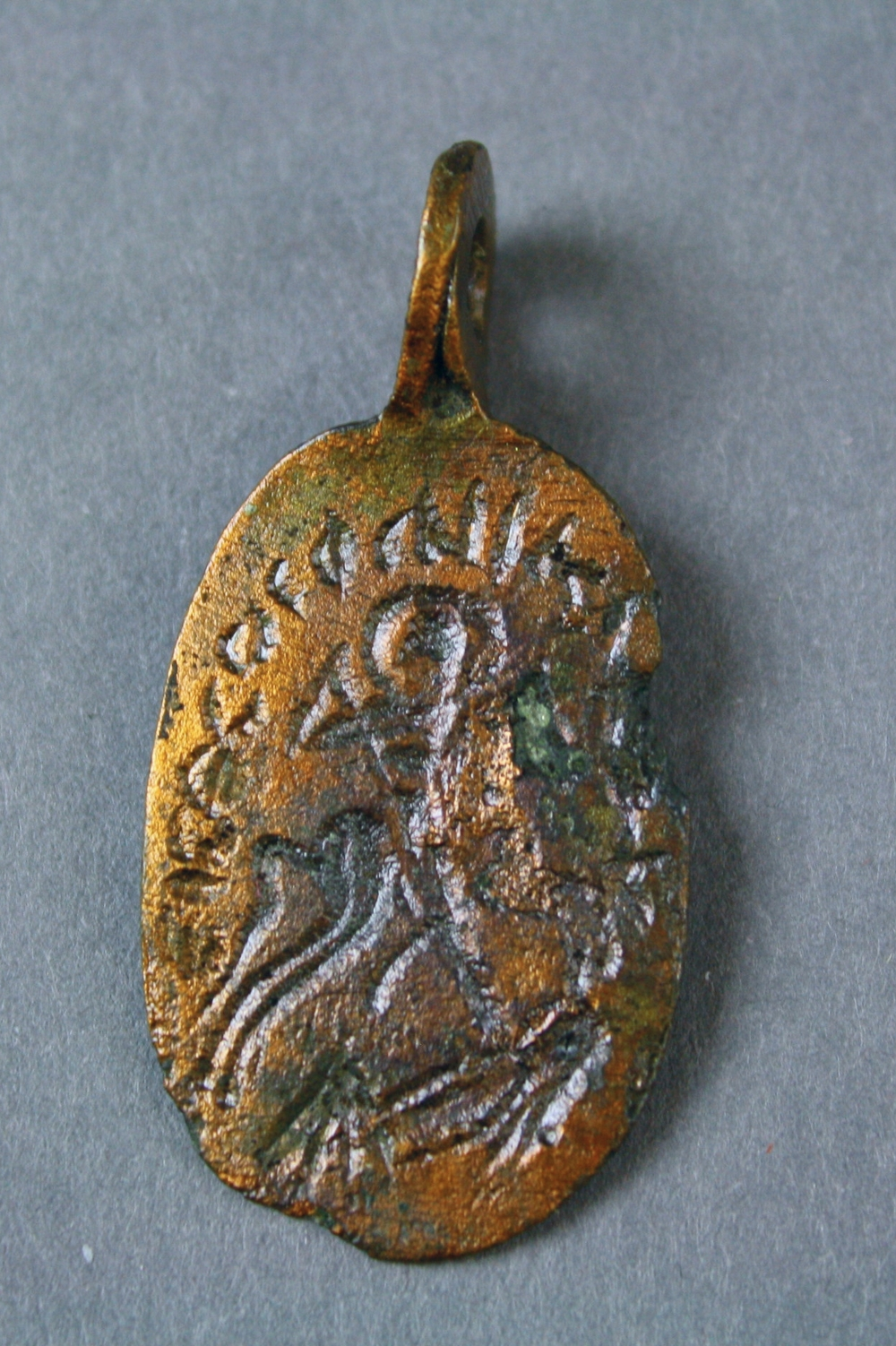 Obverse depicting the rider saint slaying a female demon.