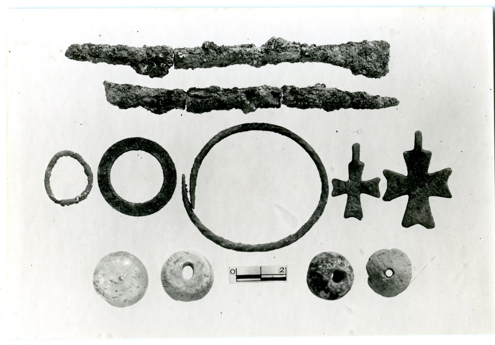 Finds, including beads, pendants and bracelets, from the burial in Room K of the Monastery.