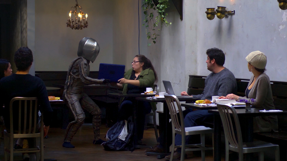 Coffee Alien SCREENGRAB - grabbing laptop.jpg