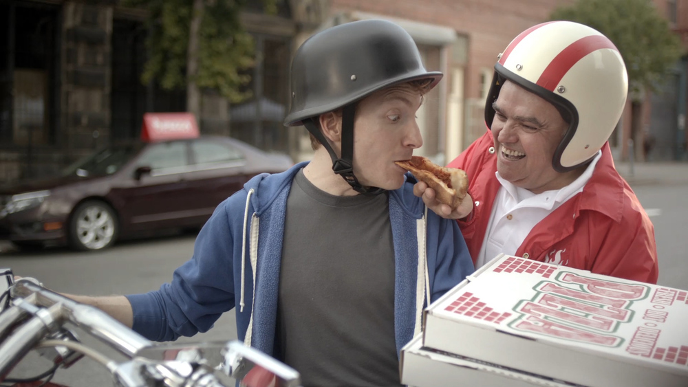 Yahoo - Wow Bike - eating pizza.jpg