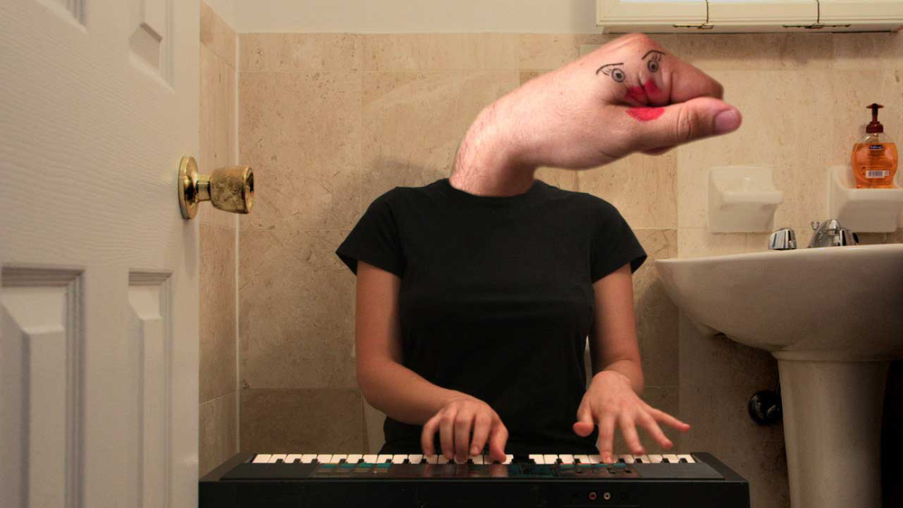 Tammi Thumb-Jaw playing piano.jpg