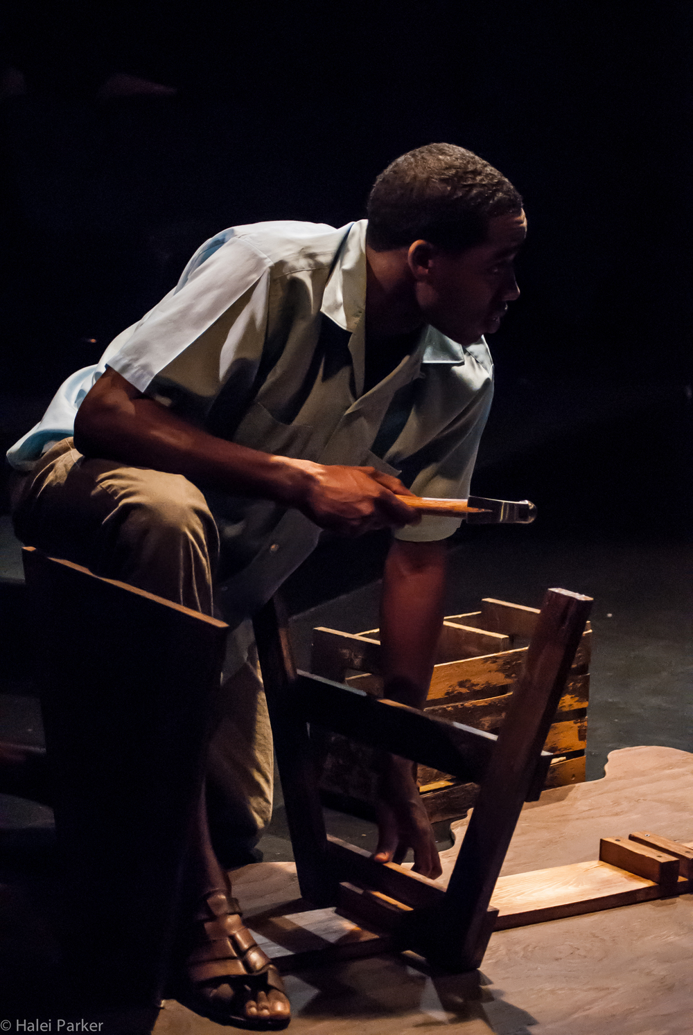 Henri-Max (Maurice Williams) builds his boat to America as he argues with Edwin.