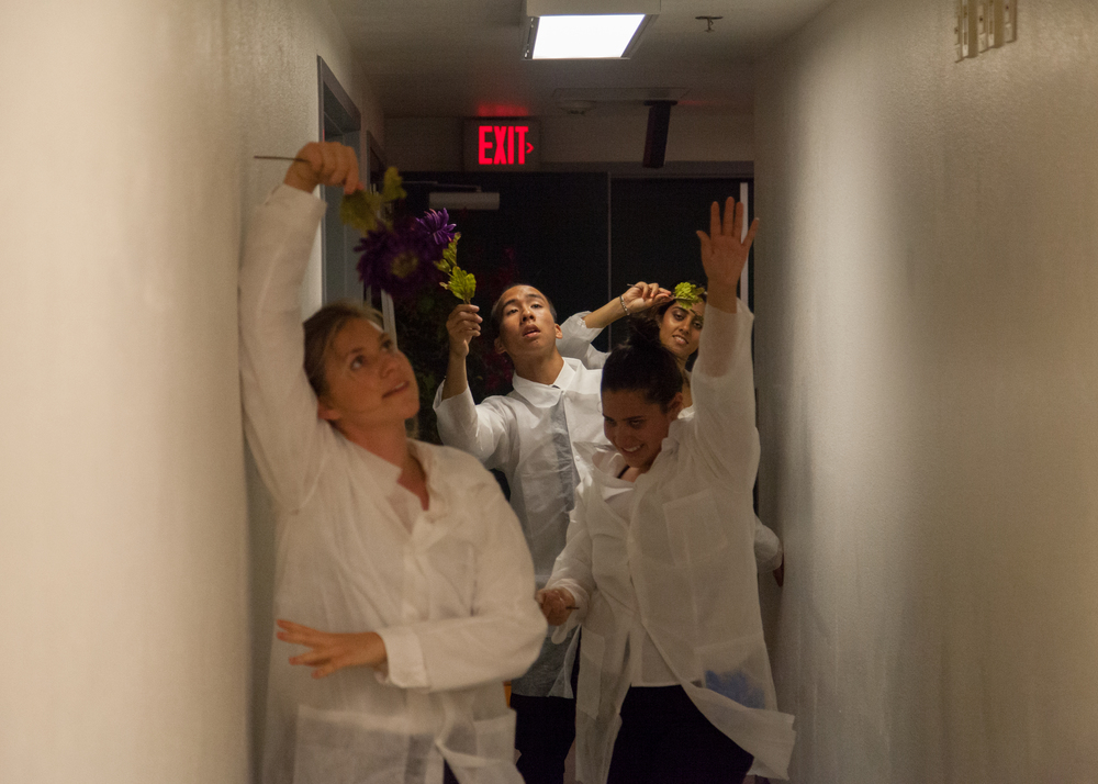 Once Ophelia has accepted her madness, the doctor's dance with flowers down the hall. (Miranda Dainard, Elisa Leveratto, Jeffrey Chan, Ruchi Thukral)