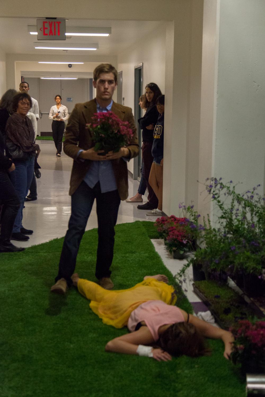 Hamlet (Tim Barnett) walks over Ophelia's (Jenny Grober) dead body.