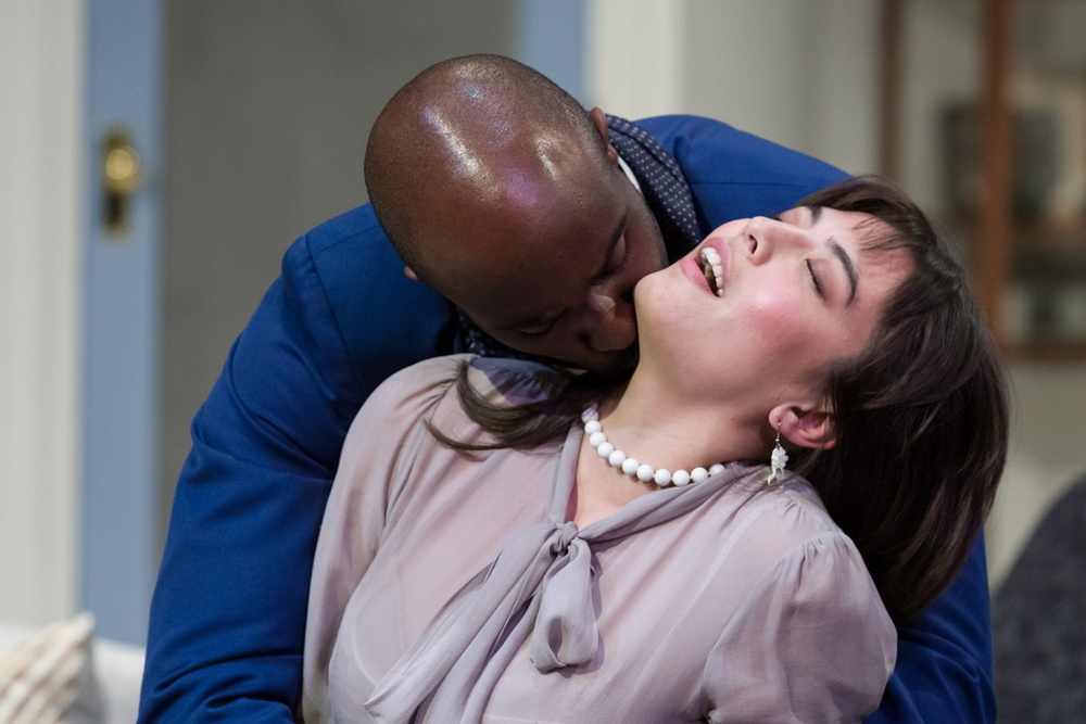 Torvald (Toby Onwumere) kisses Nora (Kim Blank) after giving her a string of pearls.