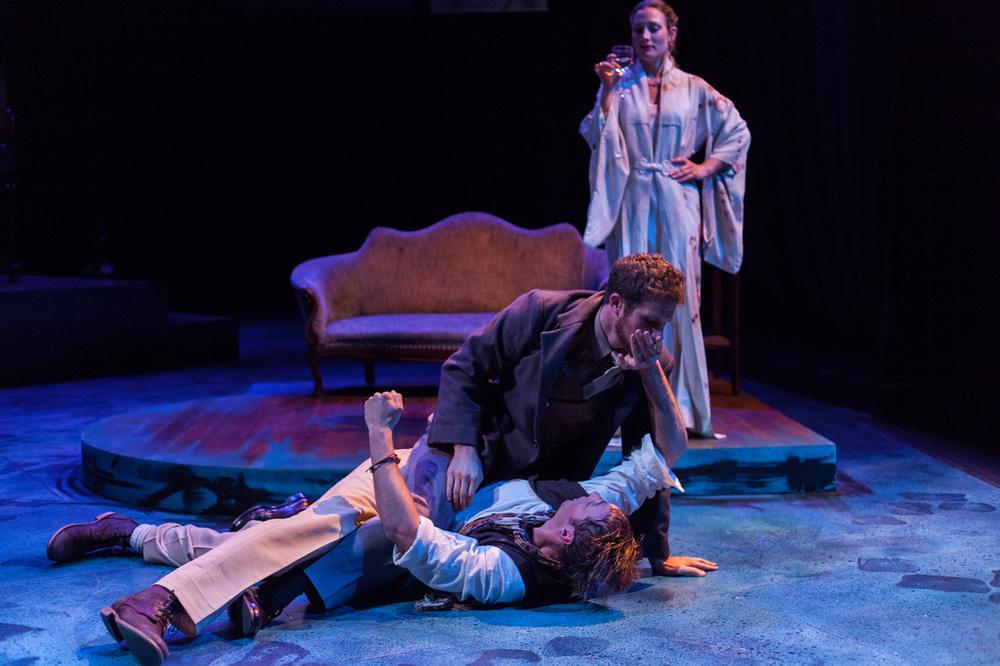 Picasso (Walker Hare) and Casagemas (Michael Hammond) drunkenly brawl on Germaine's (Hannah Tamminen) doorstep.