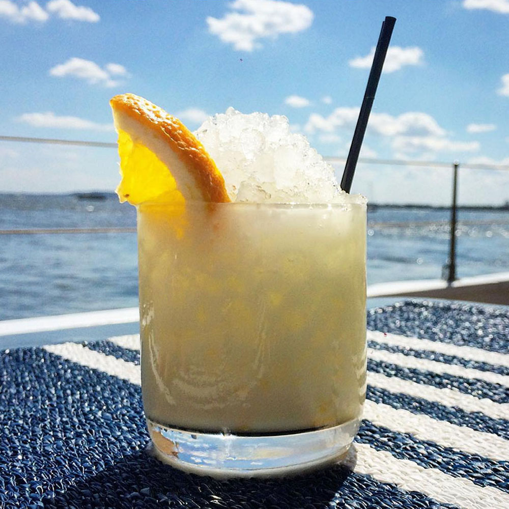 PAINKILLER ~ White Rum, Coconut Cream, Pineapple, Sun