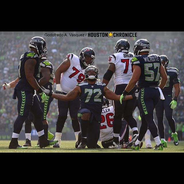 Seahawks defensive end Mijael Bennett (72) after tackling Houston Texans running back Lamar Miller (26) for a loss.  #houstontexans #seattleseahawks #photojournalism