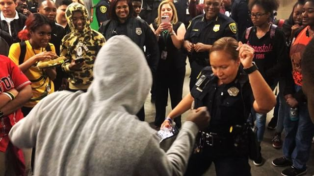 Today, I got to photograph as #Houston Police officers spent some time with #WorthingHighSchool students. Dance battles ensued. Have I mentioned how much I love my job? #photojournalism