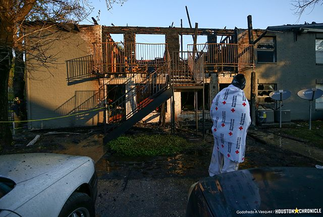 A two-alarm fire destroyed a building at the Sago Palms Apartments complex Monday morning. Among those displaced by the fire was Denesha Bagent, 26, who lost her one-year-old dog named Gucci in the blaze.  #houston #hounews #photojournalism