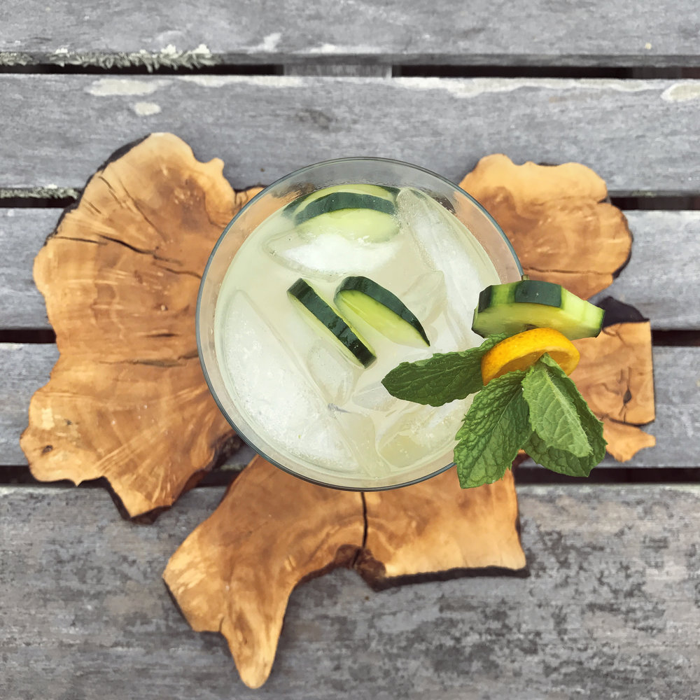 Summer Solstice: - 3 oz. Hendricks Gin.5 oz St. Germain4 slices cucumber4 kumquats½ lime1 sprig minttop with soda water