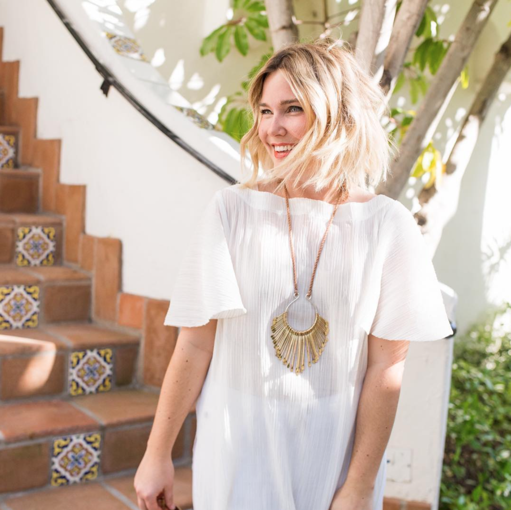 Elissa Prola white dress and pendant necklace style