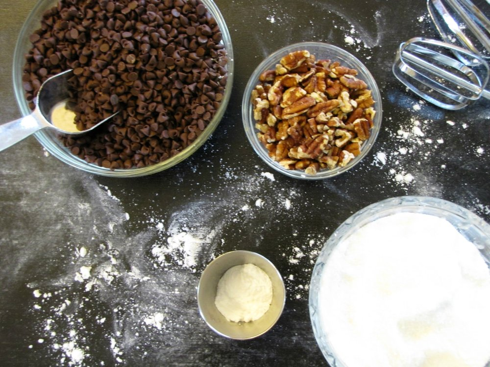 chocolate chips, nuts, and sugar in bowls