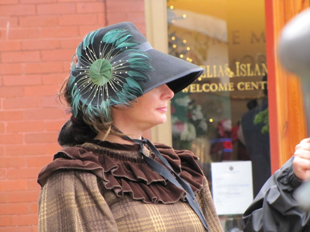 teal feather hat of period costume