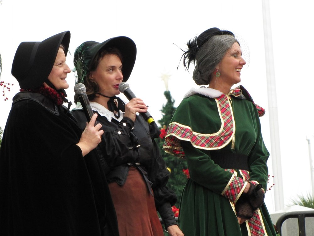 women in period costume with microphones