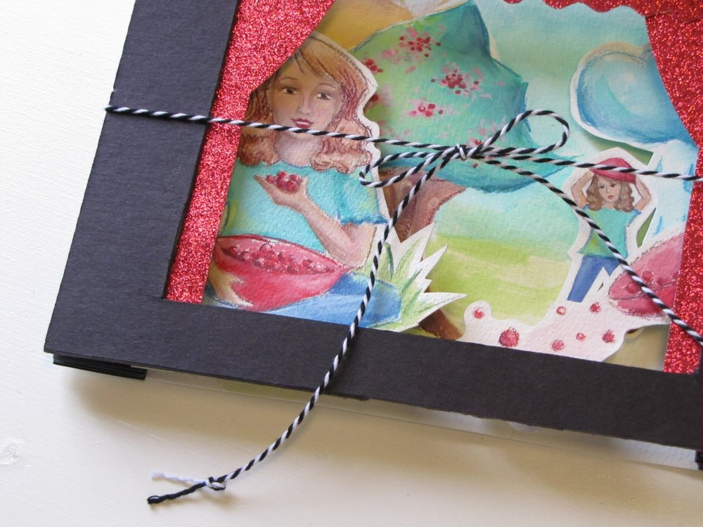 accordion tunnel book of girl and cherry tree