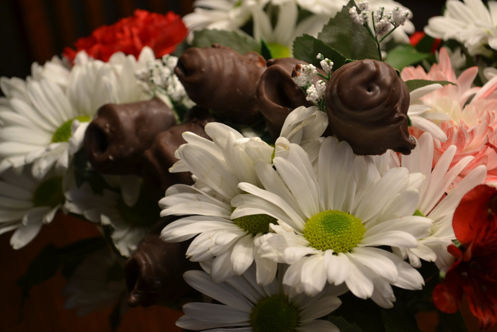 Yes, regular roses are a great gift for your significant other but what about something sweet and salty? Chocolate covered roses will hit the spot.     Learn how to make them.     As you see below we started with a bunch of artificial roses you can purchase at a craft store or a discount store.