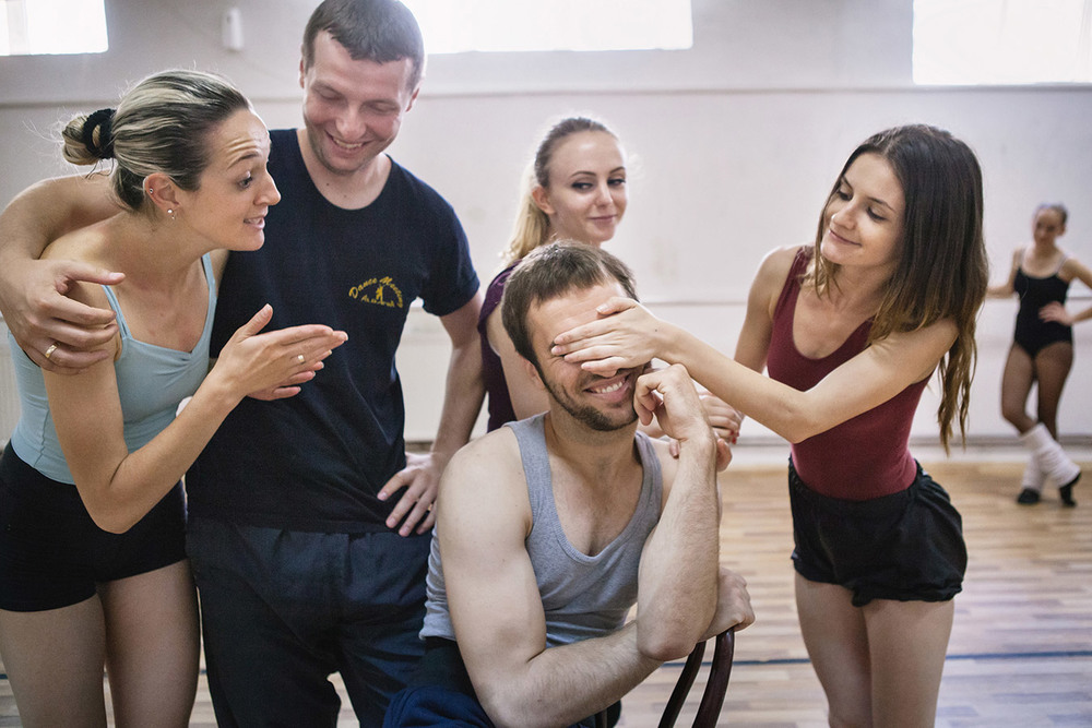 A scene during the break of a daily rehearsal at the training room of Kosovo Ballet, Kosovo National Theater, Pristina. There is very little competition within the troupe which make them like one big solid family.