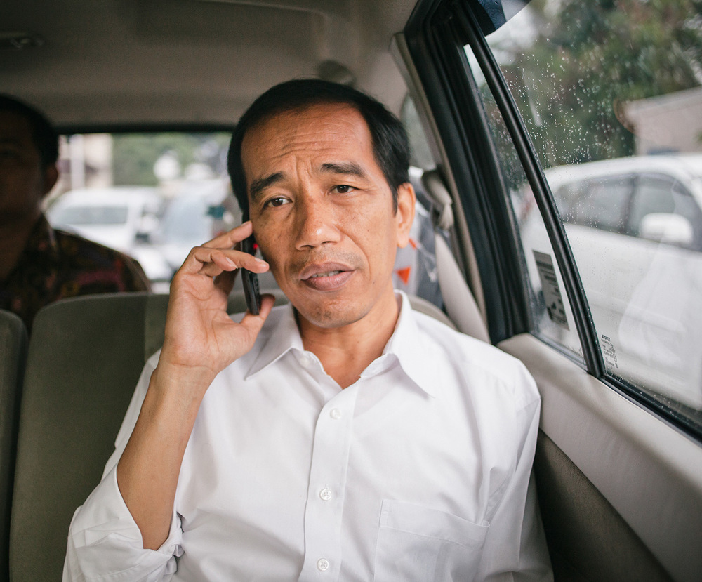 Joko Widodo talks on his phone while trapped in Jakarta's notorious traffic jam.