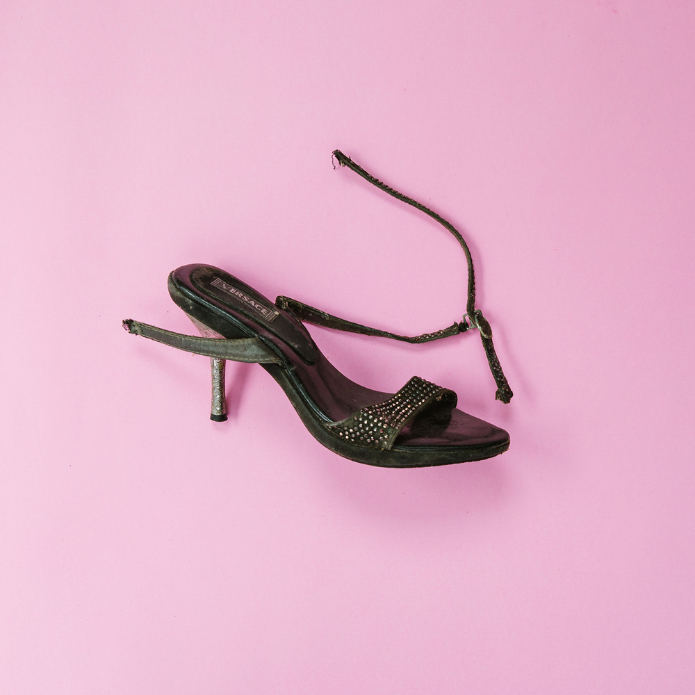 A worn-out fake Versace high heel.