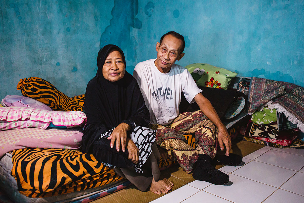 Portrait of Asmanah and her husband in their rented boarding house.