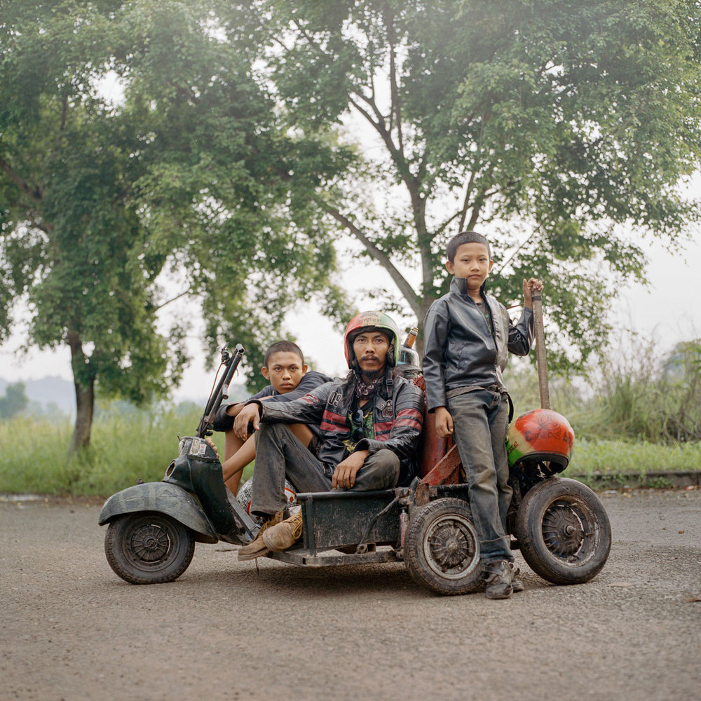 Iponk (middle), a scooterist from South Sumatra along with his son (right) and a travel companion (left). He traveled for hundreds of kilometers to attend a Vespa event in Lampung.