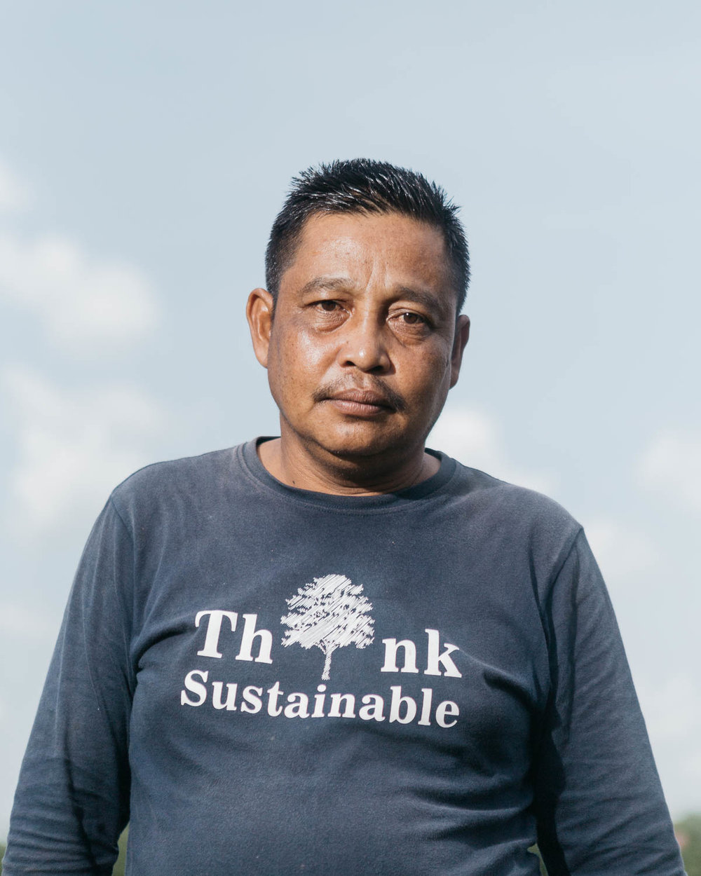 Portrait of Asdi, a villager who is benefited from Katingan Mentaya Project initiated by PT Rimba Makmur Utama. In the past he used to pratice slash and burn method for land clearing and also involved in illegal logging. He later joined the project and now actively promoting a more sustainable method for farming in his community. During the dry season, when the forest fire occasionally happen, he also acts as a firefighter.