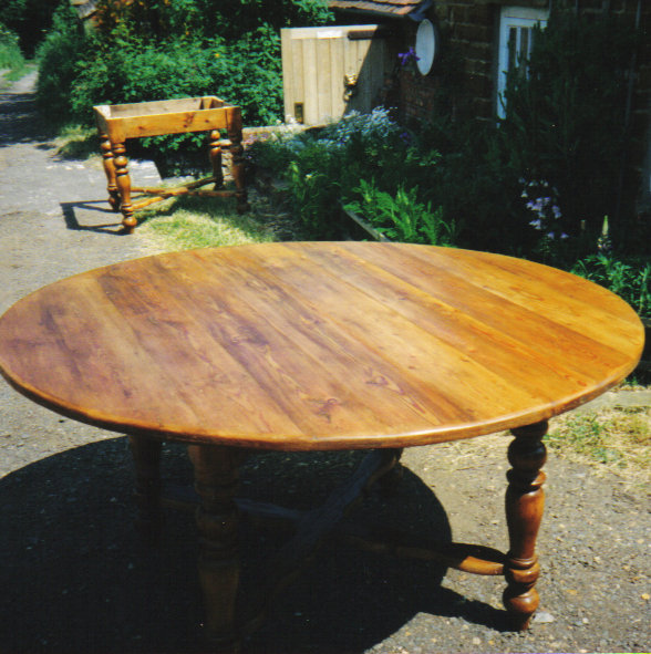 Round pine table made from old pine floorboards