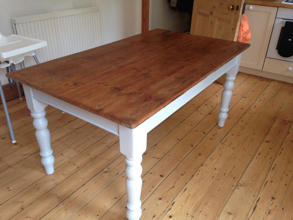 Pine table made from old pine floorboards with painted base and turned legs