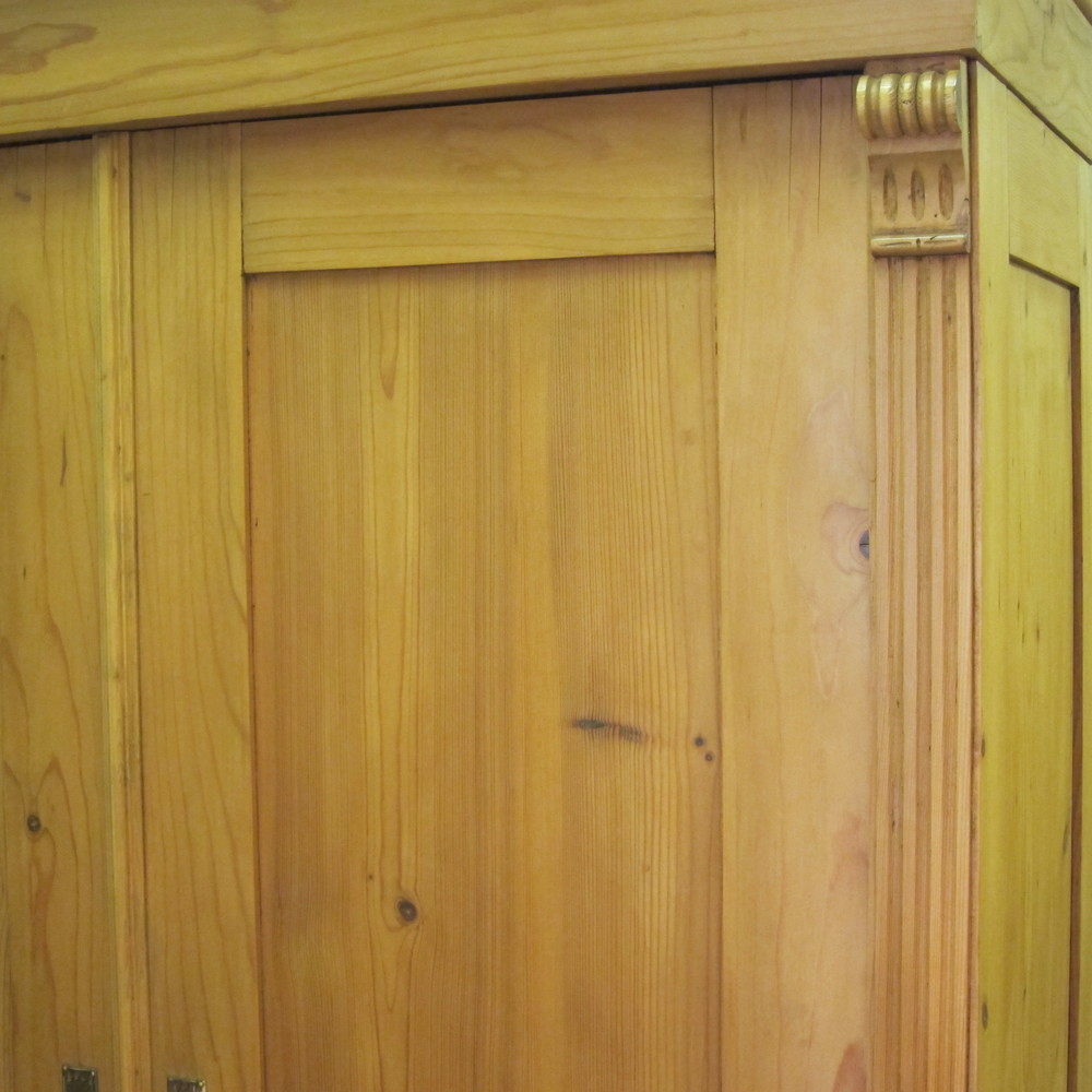 Close up waxed old pine wardrobe