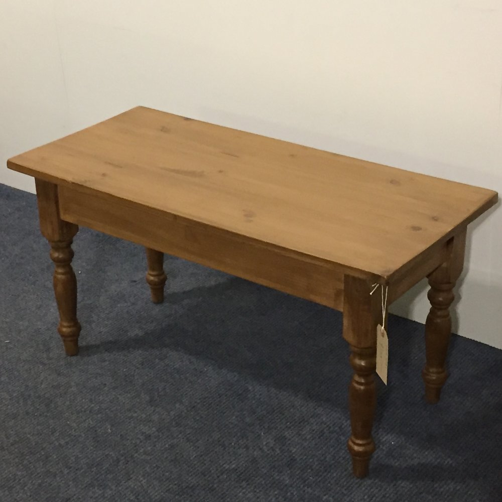 long thin pine coffee table with turned legs