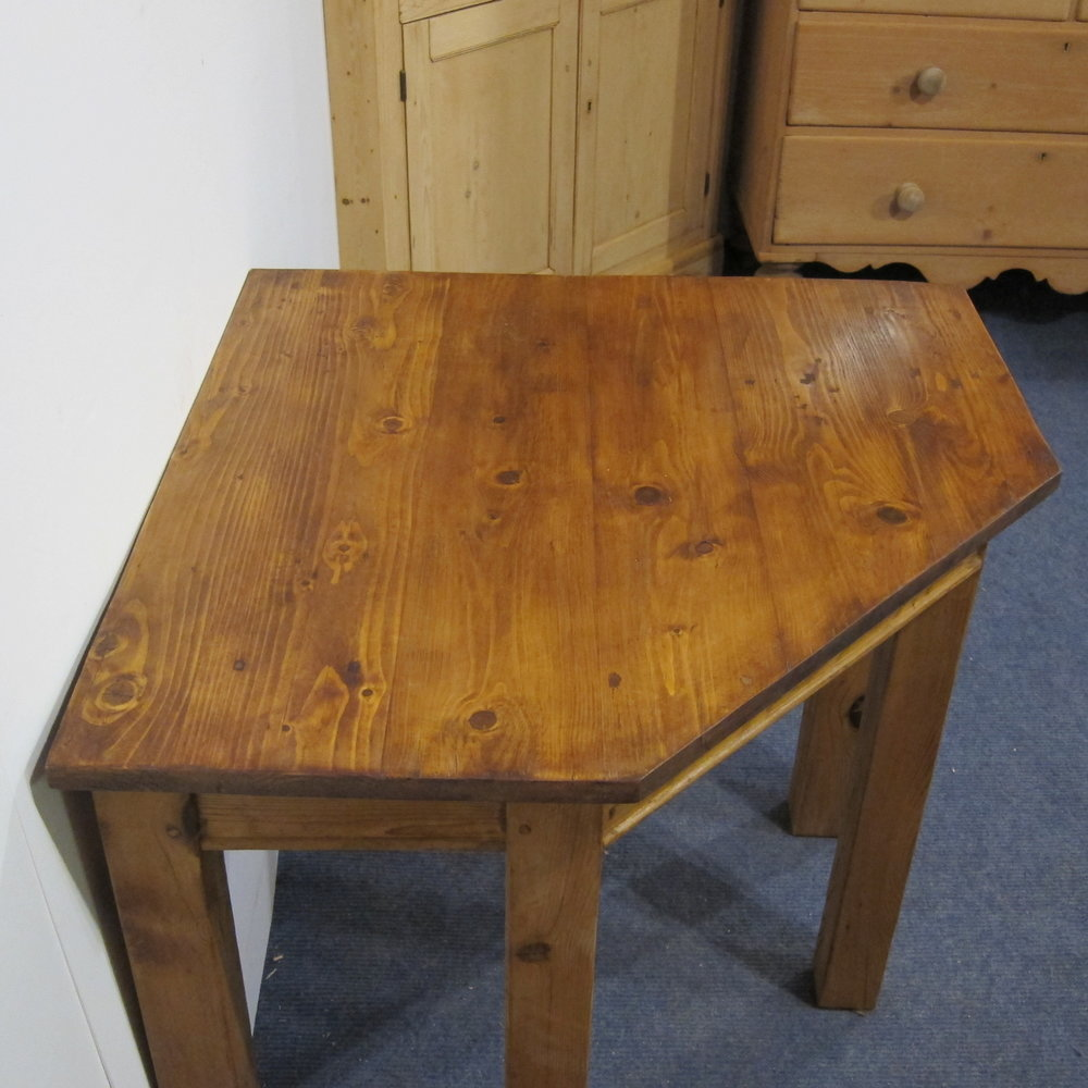 Small pine corner table made from old floorboards