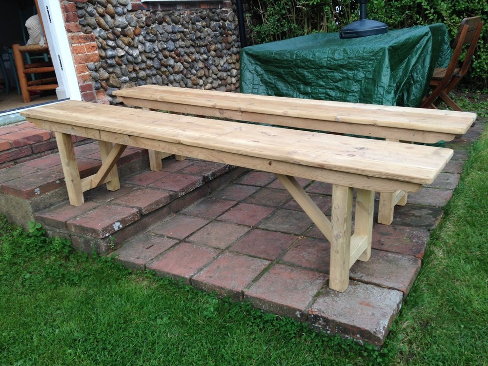 pine benches in bare wood