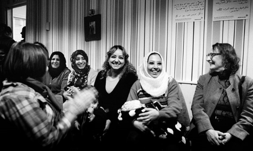 Volunteers from Nagu, a small island in Finland, laugh with refugees during a New Year's Eve concert put on by local musicians   Photo: Giles Duley/UNCHR